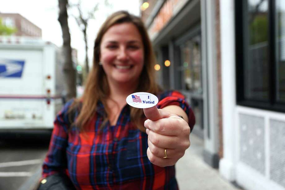 Thirty-year old Leyla Dam, owner of Lorca on Bedford Street, poses with her I Voted sticker after voting for Hillary Clinton in the Connecticut Presidential Primary on Tuesday, April 26, 2016. Photo: Michael Cummo / Hearst Connecticut Media / Stamford Advocate