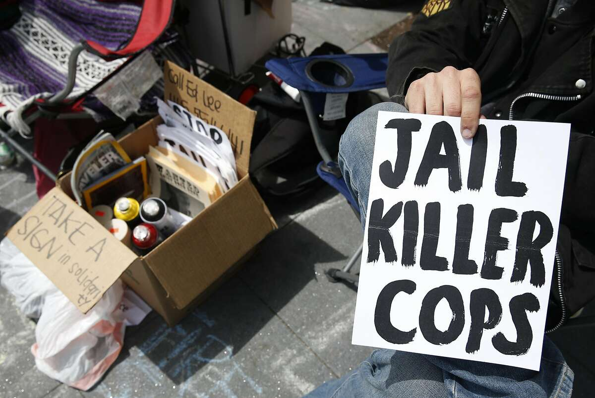 Protest leaflets are handed out as a hunger strike continues in front of the Mission police station on Valencia Street in San Francisco, Calif. on Tuesday, April 26, 2016. Activists are calling for Chief Greg Suhr to resign after a number of fatal officer involved shootings.