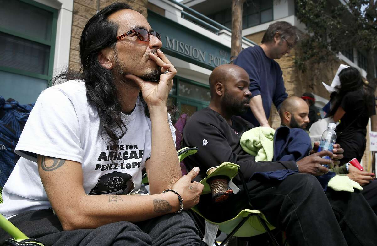 Equipto the rapper (left), Ike Pinkston (center) and Edwin Lindo lead a hunger strike in front of the Mission police station on Valencia Street in San Francisco, Calif. on Tuesday, April 26, 2016. Activists are calling for Chief Greg Suhr to resign after a number of fatal officer involved shootings.
