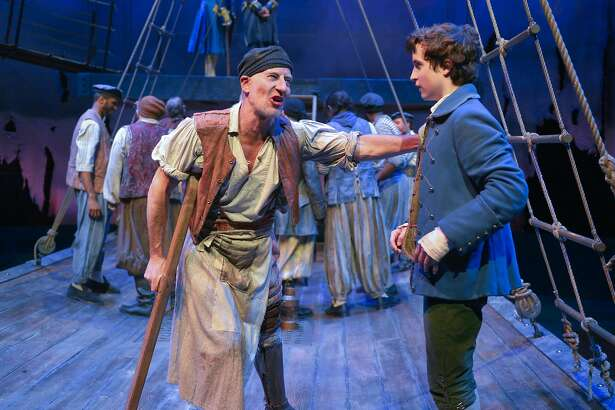 """Steven Epp (left) as Long John Silver counsels John Babbo as Jim Hawkins in Mary Zimmerman's adaptation of the Robert Louis Stevenson classic """"Treasure Island,"""" a co-production of Berkeley Repertory Theatre and Chicago's Lookingglass Theatre Company. The show runs through June 5 at the Peet's Theatre.  Photo by Kevin Berne/Berkeley Repertory Theatre"""