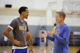 Shaun Livingston, Warriors' guard,  (l  to r)  talks with Warriors head coach Steve Kerr at the Warriors Practice Facility on Tuesday, April 26, 2016 in Oakland, California.