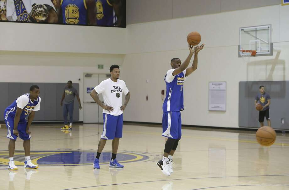 Ian Clark (right), Warriors' guard, practices shooting baskets at the Warriors Practice Facility on Tuesday, April 26, 2016 in Oakland, California. Photo: Lea Suzuki, The Chronicle