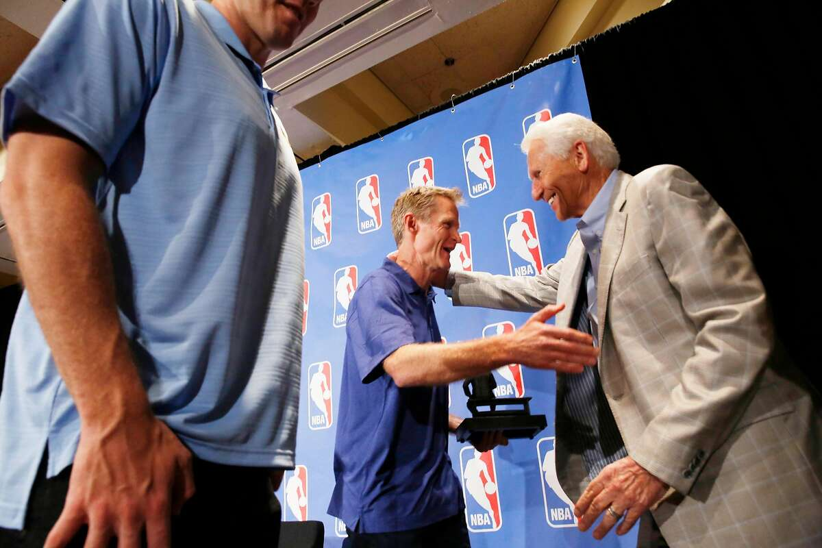 Warriors head coach Steve Kerr (center) greets Lute Olson (right), Kerr's college coach during the NBA Coach of the Year press conference on Tuesday, April 26, 2016 in Oakland, California.
