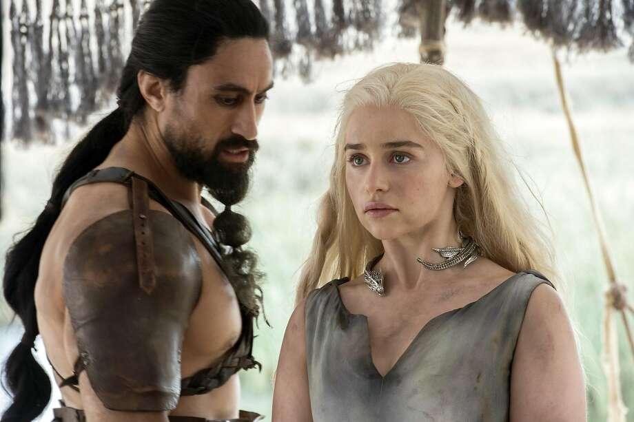 "Emilia Clarke with Joe Naufahu in ""Game of Thrones."" Photo: Macall B. Polay, Associated Press"