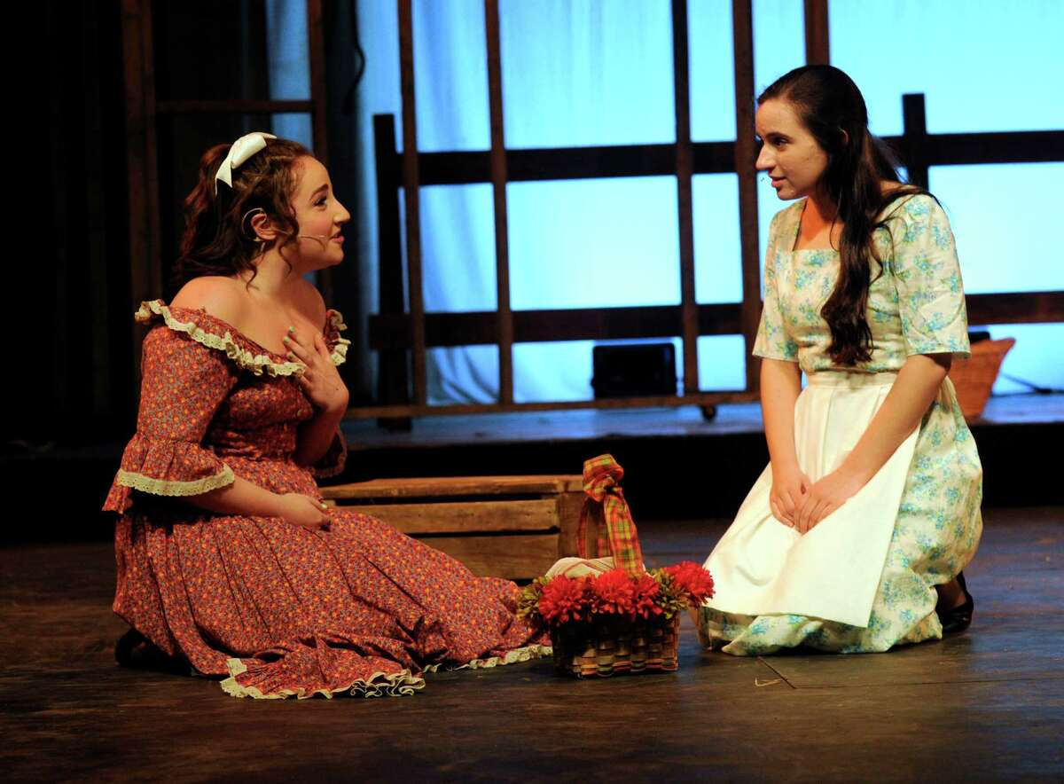 Isabella Mercaldo, left, plays Ado Annie and Marina Kolitsas plays Laurey Williams in Immaculate High School's spring musical
