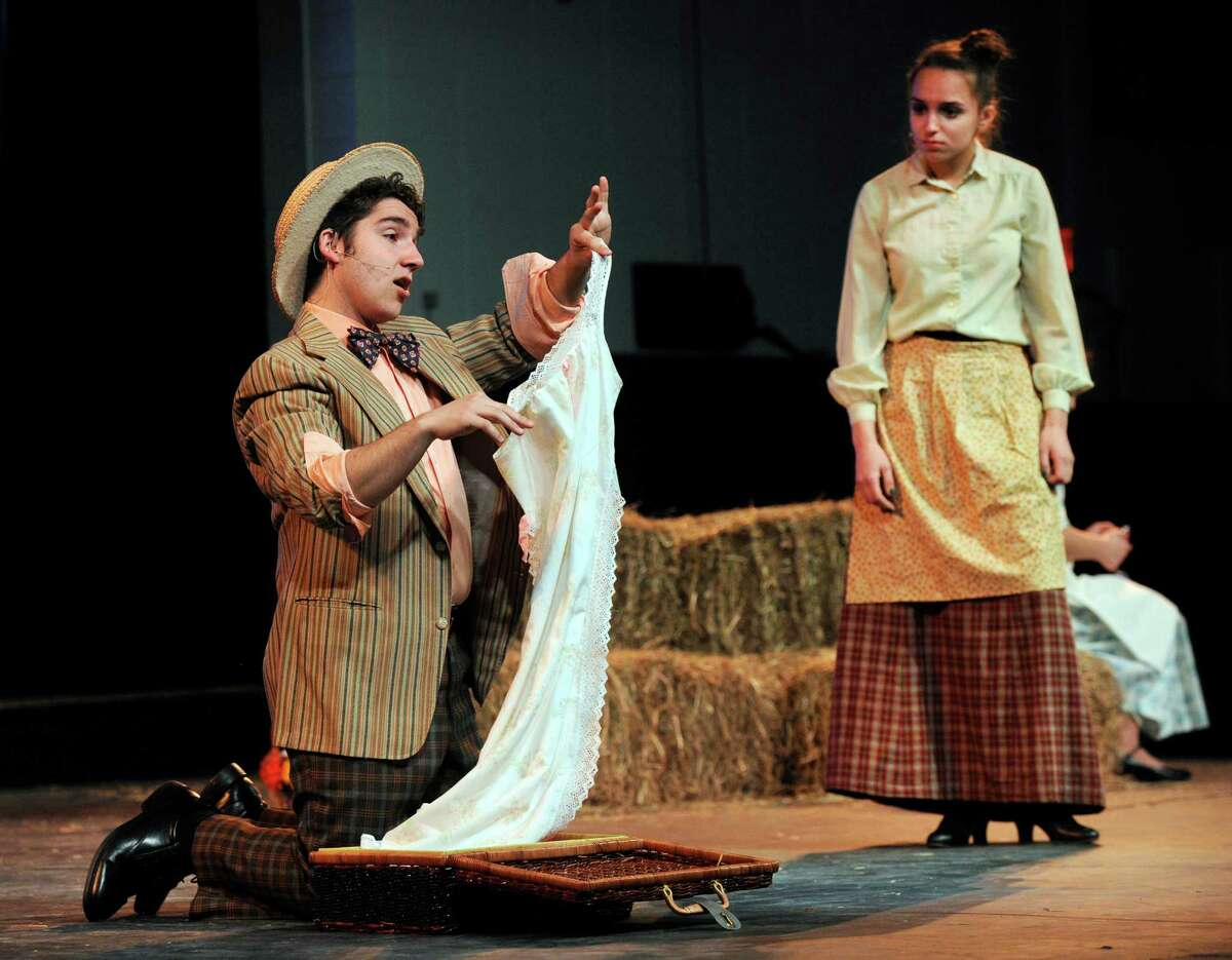 Giovanni Fardella, left, plays Ali Hakim and Nikki Rossman plays Aunt Eller in Immaculate High School's spring musical