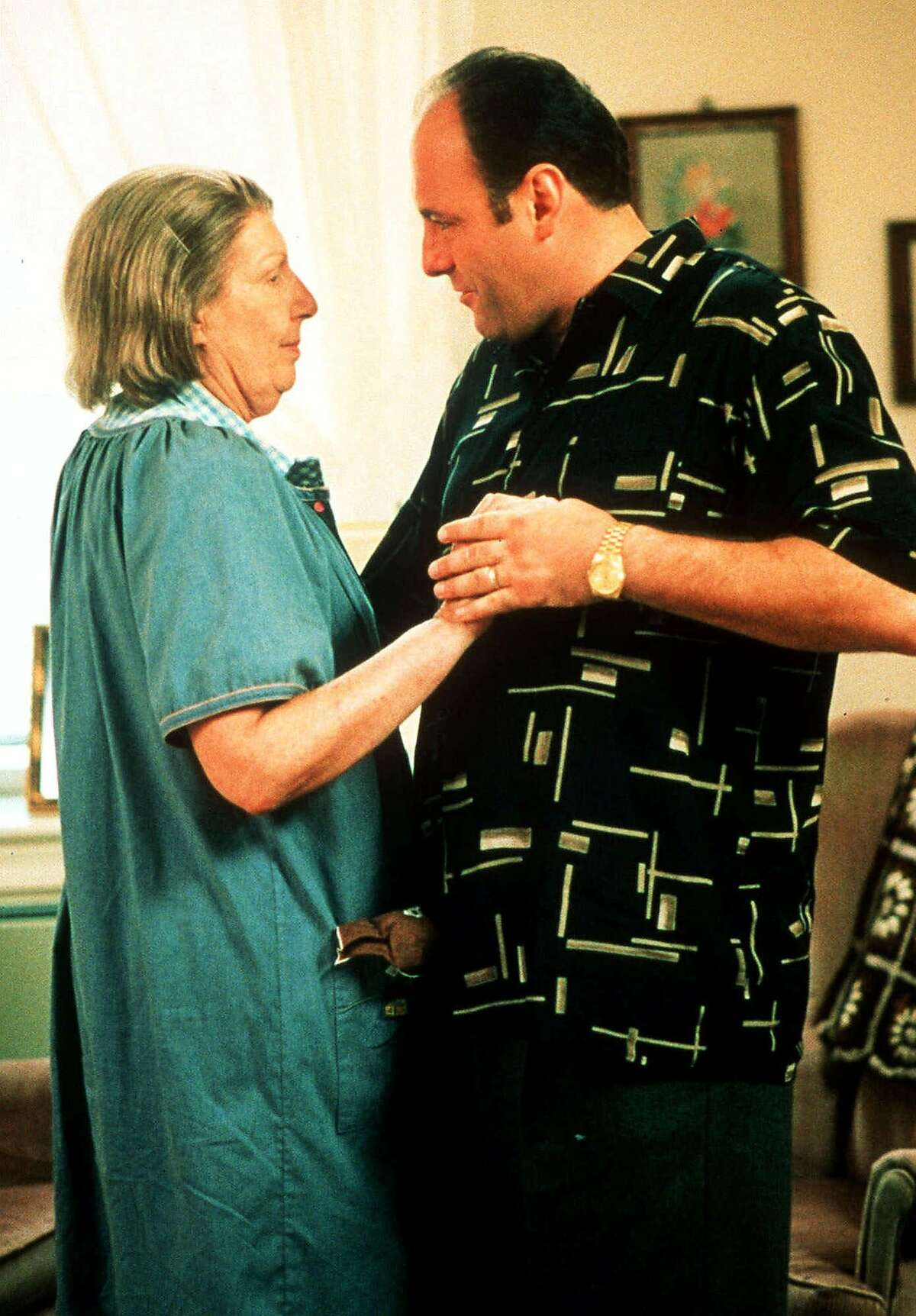 """FILE--Nancy Marchand and James Gandolfini, who play mother and son in the hit HBO drama series """"The Sopranos"""", are shown in this undated file photo. The series received 18 Emmy nominations in Los Angeles, Calif., Thursday, July 20, 2000. Marchand, who died in June, was nominated for best supporting actress in a drama series. Gandolfini was nominated for Best Actor.(AP Photo/Anthony Neste, HBO, File)"""