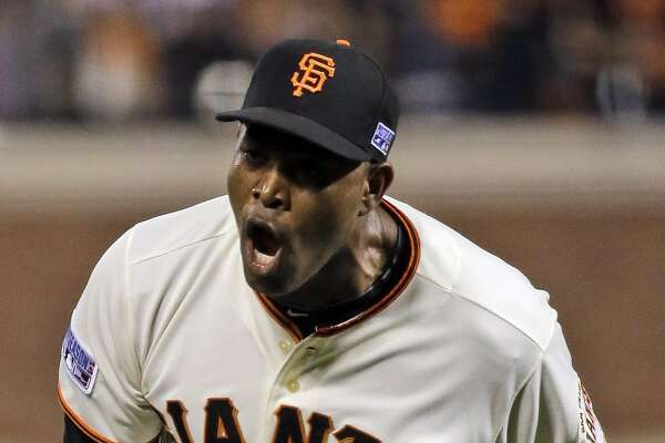 San Francisco Giants relief pitcher Santiago Casilla celebrates at the end of the game against the St. Louis Cardinals during the Game 4 of the National League baseball championship series Wednesday, Oct. 15, 2014, in San Francisco. The Giants won 6-4 to lead the series 3-1. (AP Photo/Jeff Roberson)