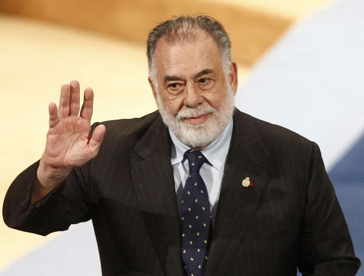 Filmmaker Francis Ford Coppola acknowledges applause.