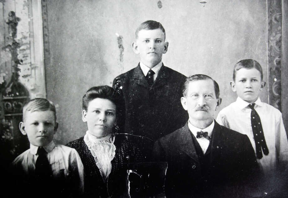 A look at the Butt family taken about the time of the opening of the first H.E.B. store in Kerrville in 1905. (L-R) Howard (Sr.), mother Florence, Charles Jr. (standing), father Charles Sr. and Eugene. Photo: KEVIN GEIL / SAN ANTONIO EXPRESS-NEWS / SAN ANTONIO EXPRESS-NEWS
