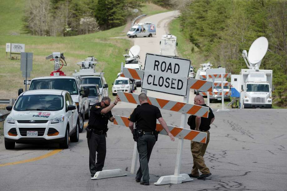 FILE - In this Friday, April 22, 2016 file photo, authorities set up road blocks at the intersection of Union Hill Road and Route 32 at the perimeter of a crime scene, in Pike County, Ohio. As the investigation into the killings of eight family members in rural Ohio enters its fifth day, more details are being released. Pike County Prosecutor Rob Junk told The Columbus Dispatch Monday, April 25, 2016, that the marijuana operations discovered at three of the four crime scenes included a grow-house sheltering hundreds of plants.  (AP Photo/John Minchillo, File) Photo: John Minchillo, STF / AP