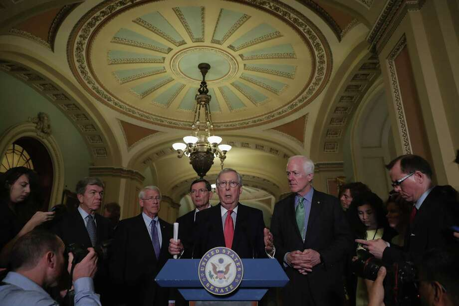 Senate Majority Leader Mitch McConnell (at lecturn) and Sen. John Cornyn (far right) are at odds about how much money the federal government should spend on preparation and prevention of the spread of the Zika virus once it affects the U.S. Photo: Chip Somodevilla, Staff / 2016 Getty Images