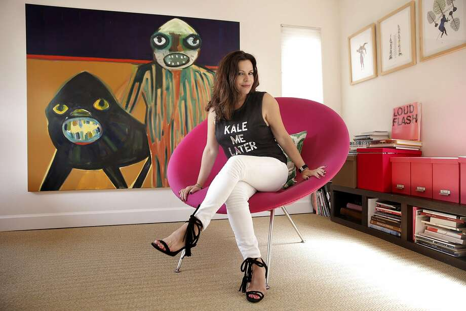 """Art consultant Alexandra Ray sits in front of """"King of the Jumble"""" 2011 by London artist Carla Busuttil, which hangs in her office at her home San Rafael Photo: Michael Macor, The Chronicle"""