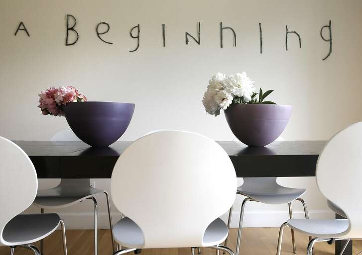 """The dinning room has a bronze installation by Martin Bialas called, """"A Beginning"""" at art consultant Alexandra Ray's home in San Rafael, California on Tues. April 26, 2016. Ray is constantly mixing artwork with her home furnishings but manages to keep the house feeling like a house not a gallery."""