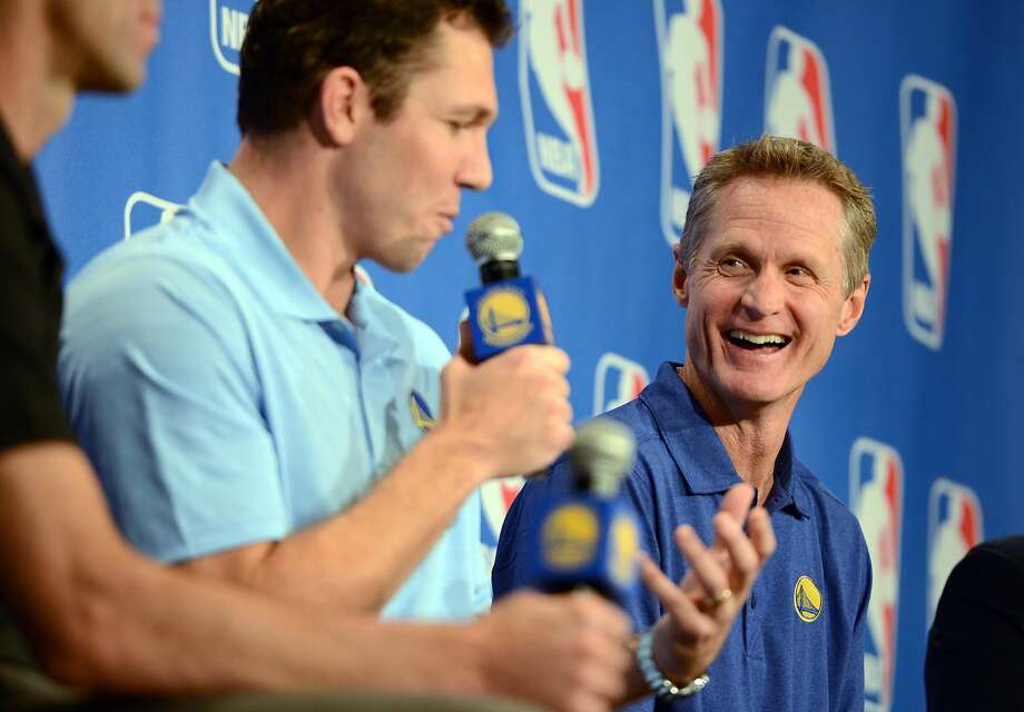 Golden State Warriors head coach Steve Kerr, right, listens as assistant coach Luke Walton addresses the media after Kerr was named the NBA coach of the year, Tuesday, April 26, 2016, in Oakland, Calif. Kerr won the award after leading to the Golden State Warriors to the best regular season record in league history. Kerr got 64 first-place votes from the panel of 130 media members who regularly cover the league. Portland's Terry Stotts was second in relatively close voting. San Antonio's Gregg Popovich was third. (Kristopher Skinner/Oakland Tribune via AP) MANDATORY CREDIT Photo: Kristopher Skinner, Associated Press
