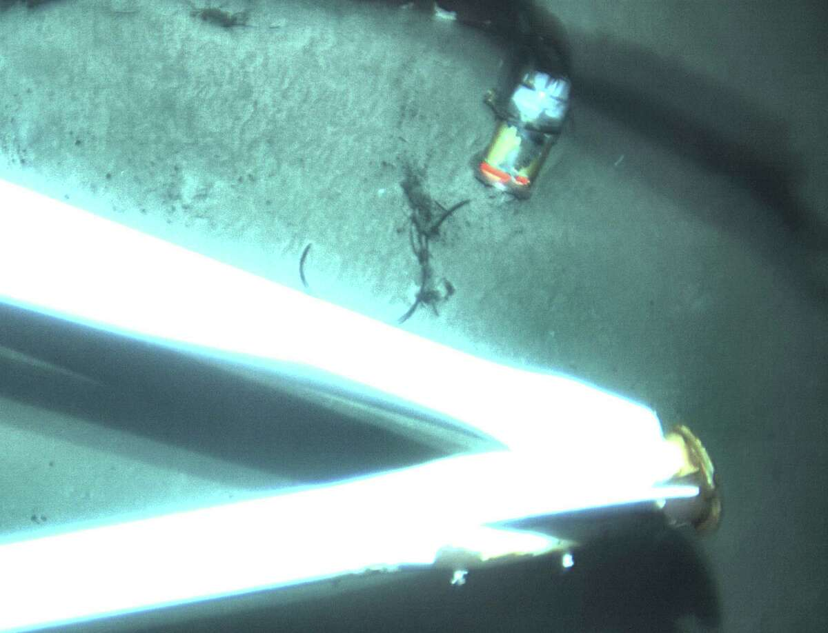 This undated image made from a video and released Tuesday, April 26, 2016, by the National Transportation Safety Board shows the data recorder, top right, of the sunken ship El Faro. The data recorder was located northeast of Acklins and Crooked Islands, Bahamas. El Faro, a 790-foot freighter, sank last October after getting caught in Hurricane Joaquin. The data recorder is capable of recording conversations and sounds on the El Faro's bridge, which may help investigators better understand the final moments of the ship's final journey. (National Transportation Safety Board via AP) MANDATORY CREDIT