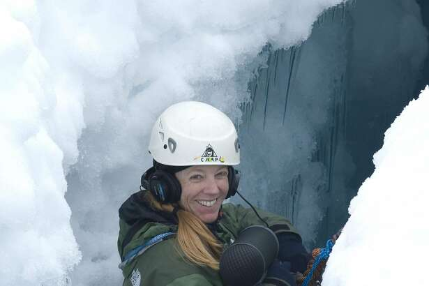San Francisco composer Cheryl Leonard, seen here in 2008 recording sounds in a crevasse on the Marr Ice Piedmont on Anvers Island in Antarctica, performs her polar soundscapes May 11 at Berkeley's David Brower Center.