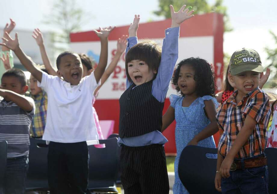Pre-K 4 SA students sing and dance to will.i.am's What I am during their promotion ceremony at Pre-k 4 SA South in June 2014. Students who have completed the Pre-K 4 SA program were promoted to kindergarten during the ceremony honoring their first education milestone. Photo: Helen L. Montoya /San Antonio Express-News / ©2014 San Antonio Express-News