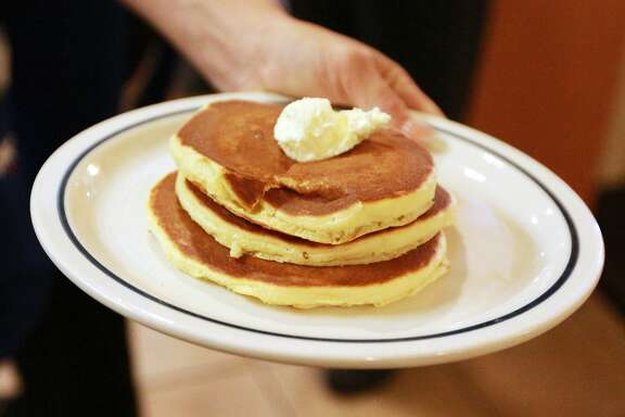 Free pancakes are on their way out of the kitchen during National Pancake Day at IHOP on Tuesday, March, 8, 2016 in Odessa, Texas. (Jacob Ford/Odessa American via AP) MANDATORY CREDIT