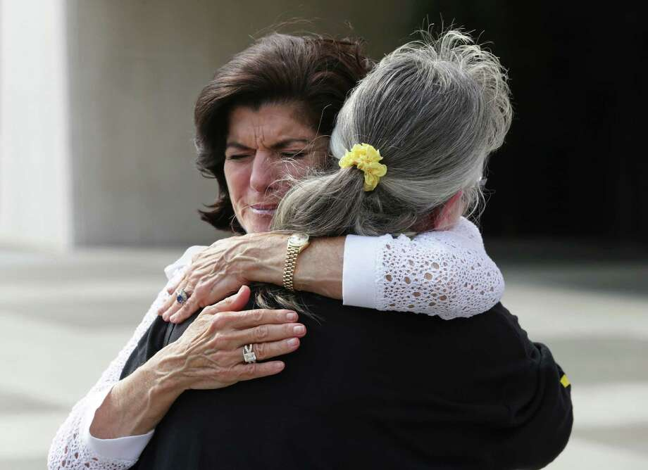 Luci Baines Johnson hugs Leah Smith Angers who is the brother of William D. Smith, killed in Vietnam, as the Vietnam War Summit is hosted by the LBJ Presidential Library on April 26, 2016. Photo: TOM REEL, STAFF / SAN ANTONIO EXPRESS-NEWS / 2016 SAN ANTONIO EXPRESS-NEWS