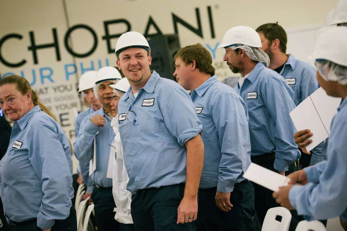 Workers at Chobani react at a meeting where the yogurt makerOs founder handed over a roughly 10 percent ownership stake, in New Berlin, N.Y., April 26, 2016. Hamdi Ulukaya's gift could make some of the yogurt maker's 2,000 full-time employees into millionaires. (Alexandra Hootnick/The New York Times) ORG XMIT: XNYT103