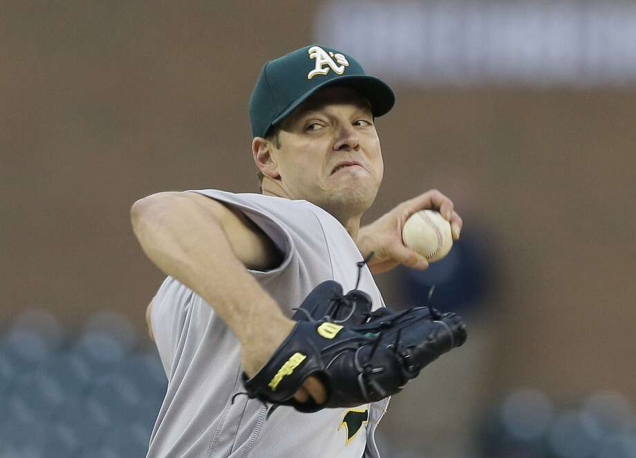 Oakland Athletics starting pitcher Rich Hill throws during the first inning of a baseball game against the Detroit Tigers, Tuesday, April 26, 2016, in Detroit. (AP Photo/Carlos Osorio) Photo: Carlos Osorio, Associated Press