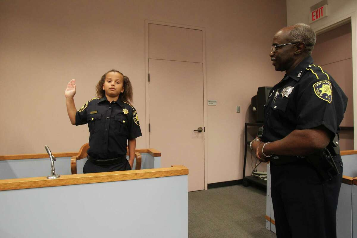 Sarah-Beth Mathis is sworn in by Deputy Floyd Carr in Judge Dale Gorczynski courtroom Tuesday, April 26, 2016, in Houston. Sarah-Beth has suffered from numerous illnesses since birth including PTEN Gene Mutation. The Harris County Constables office will make her a cop for a day.