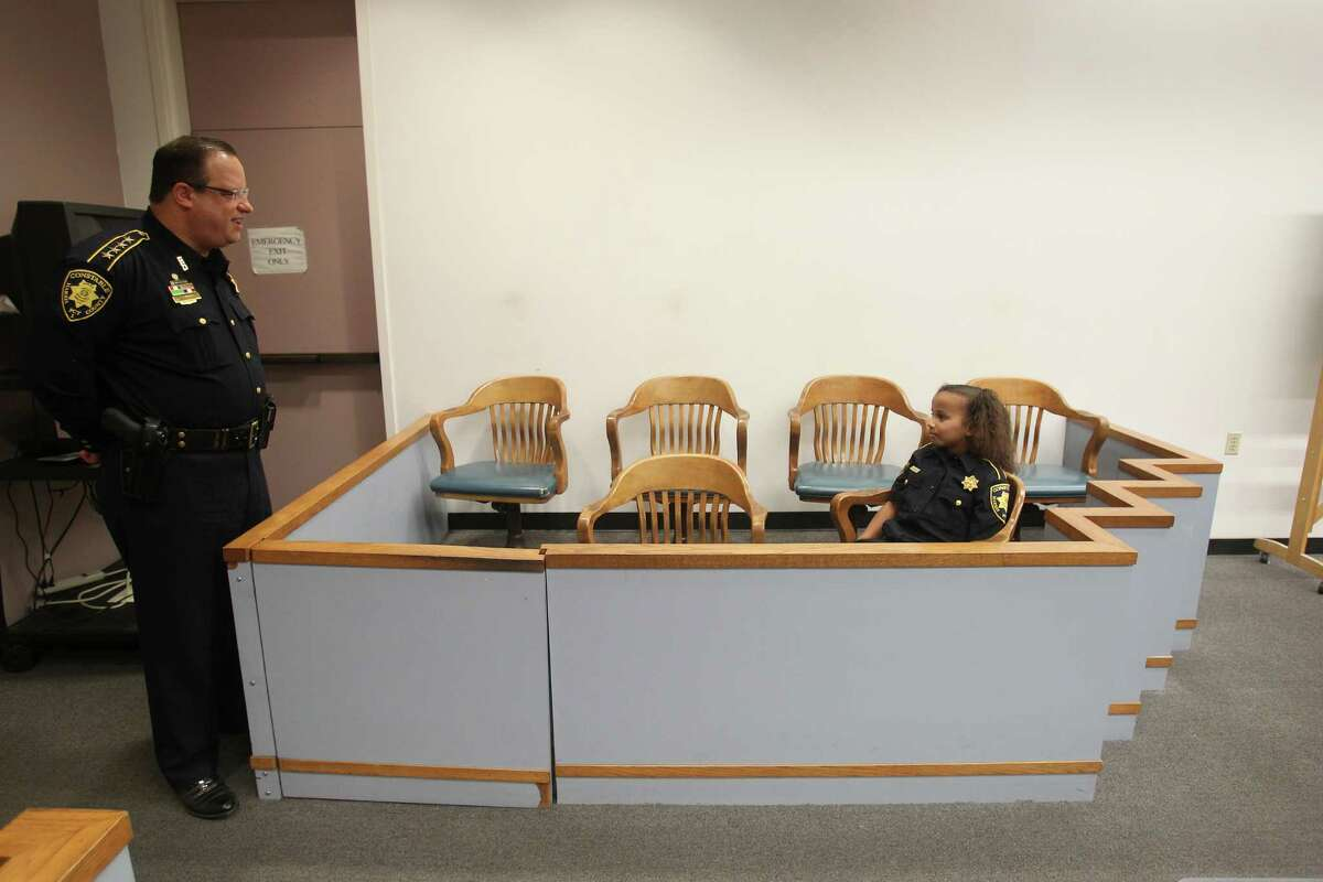 Sarah-Beth Mathis sits in the jury box in Judge Dale Gorczynski courtroom Tuesday, April 26, 2016, in Houston. Sarah-Beth has suffered from numerous illnesses since birth including PTEN Gene Mutation. The Harris County Constables office will make her a cop for a day.