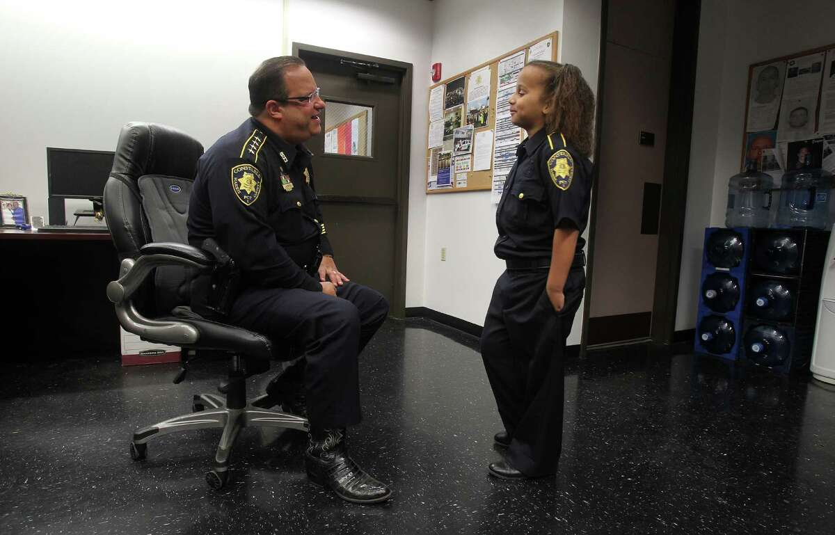 Sarah-Beth Mathis has a brief conversation with Constable Alan Rosen before she became an honorary Deputy for a day Tuesday, April 26, 2016, in Houston. Sarah-Beth has suffered from numerous illnesses since birth including PTEN Gene Mutation. The Harris County Constables office will make her a cop for a day.