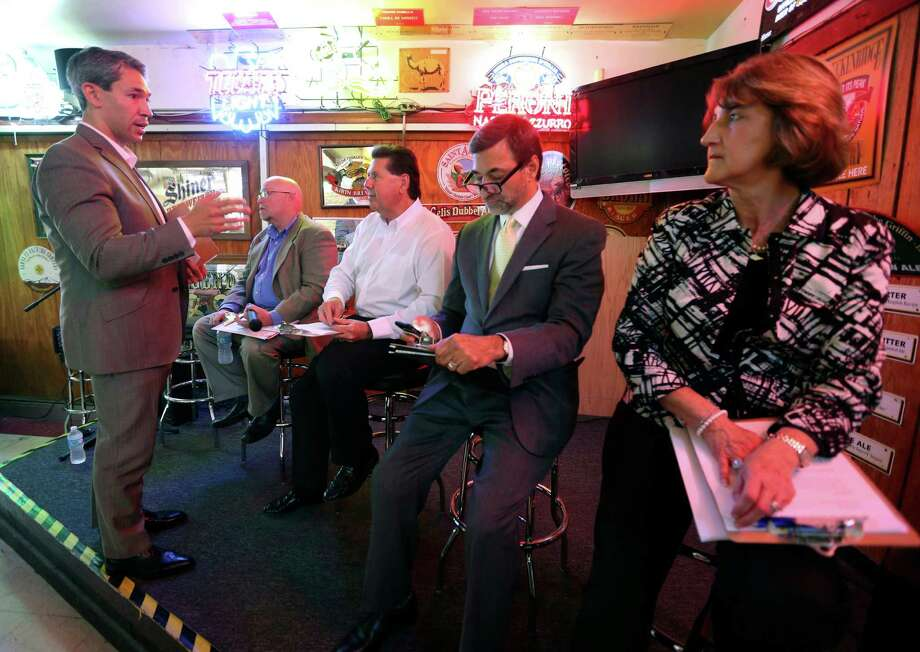 Councilman Ron Nirenberg, left, talks Tuesday, April 26, 2016 at Hills and Dales Ice House to panelists at his monthly town hall meeting. The panelists were, from left: Burl Yarbrough, President of San Antonio Missions Baseball Club; Russ Bookbinder, President and CEO of San Antonio Sports, Michael Sawaya, Executive Director of Convention and Sports Facilities, and Lynn Hickey, Athletic Director at UTSA. Photo: William Luther, Staff / San Antonio Express-News / © 2016 San Antonio Express-News