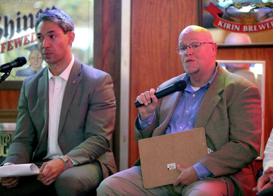 Councilman Ron Nirenberg (left) listens on April 26, 2016 at Hills and Dales Ice House as Burl Yarbrough, president of San Antonio Missions, talks about the prosects of professional sports expansion in San Antonio. Photo: William Luther /San Antonio Express-News / © 2016 San Antonio Express-News
