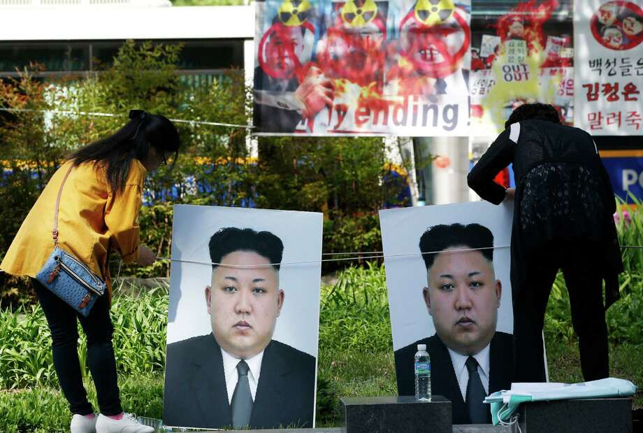 Participants set the portraits of North Korean leader Kim Jong Un during a rally denouncing North Korea's nuclear test and missiles and North Korea's female military human rights in Seoul, South Korea, Tuesday, April 26, 2016. The rally is a part of an annual event called North Korea Freedom Week which held from April 24-30. North Korea is believed to have placed a new, powerful mid-range missile on standby for an impending launch, a news report said Tuesday. (AP Photo/Lee Jin-man) Photo: Lee Jin-man, STF