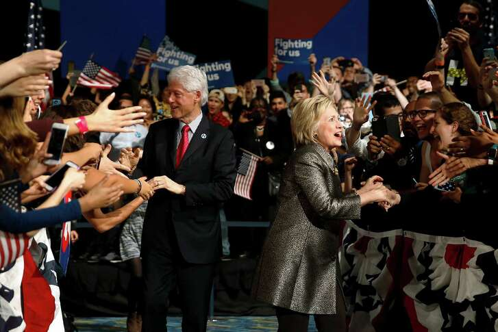 Democratic presidential candidate Hillary Clinton and Former President Bill Clinton move to the stage at her presidential primary election night rally, Tuesday, April 26, 2016, in Philadelphia.