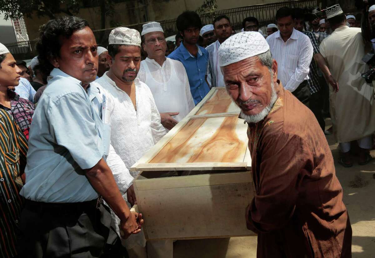 Bangladeshi Muslims carry the body of Xulhaz Mannan who was stabbed to death by unidentified assailants for his funeral in Dhaka, Bangladesh, Tuesday, April 26, 2016. The banned group Ansar-al Islam, the Bangladeshi branch of al-Qaida on the Indian subcontinent, has claimed responsibility for the killings of gay rights activist Mannan and his friend in the capital, Dhaka. (AP Photo)