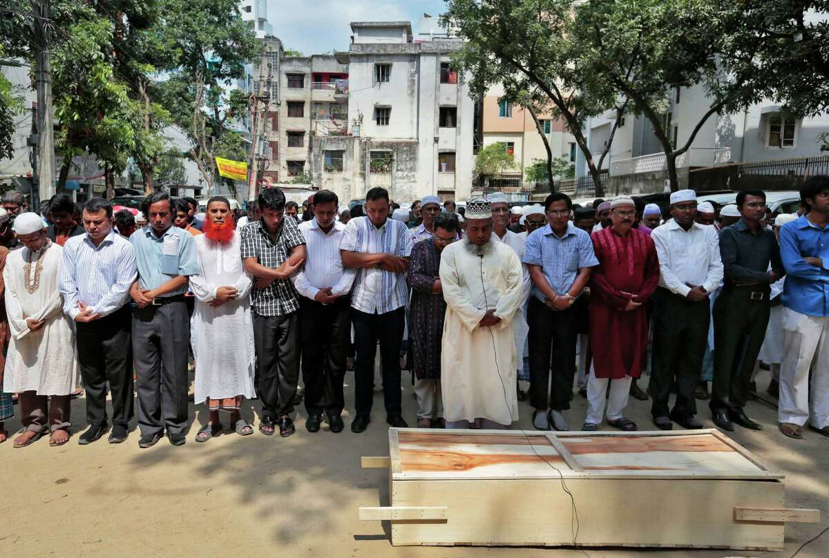 Bangladeshi Muslims attend the funeral of Xulhaz Mannan who was stabbed to death by unidentified assailants, in Dhaka, Bangladesh, Tuesday, April 26, 2016. The banned group Ansar-al Islam, the Bangladeshi branch of al-Qaida on the Indian subcontinent, has claimed responsibility for the killings of gay rights activist Mannan and his friend in the capital, Dhaka. (AP Photo)
