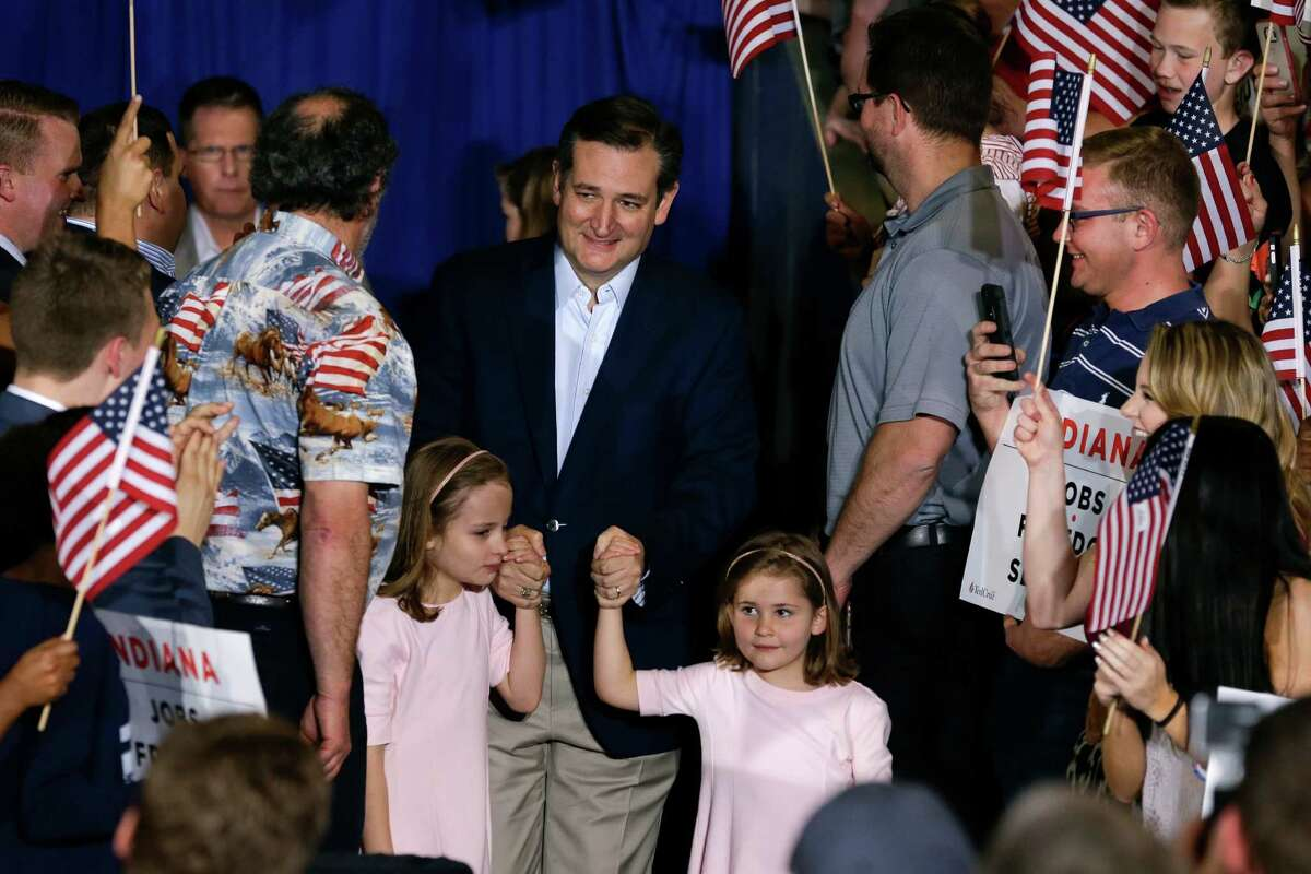 Republican presidential candidate Sen. Ted Cruz, R-Texas, takes the stage with his daughters Caroline, left, and Catherine for a rally at the Hoosier Gym in Knightstown, Ind., Tuesday, April 26, 2016.