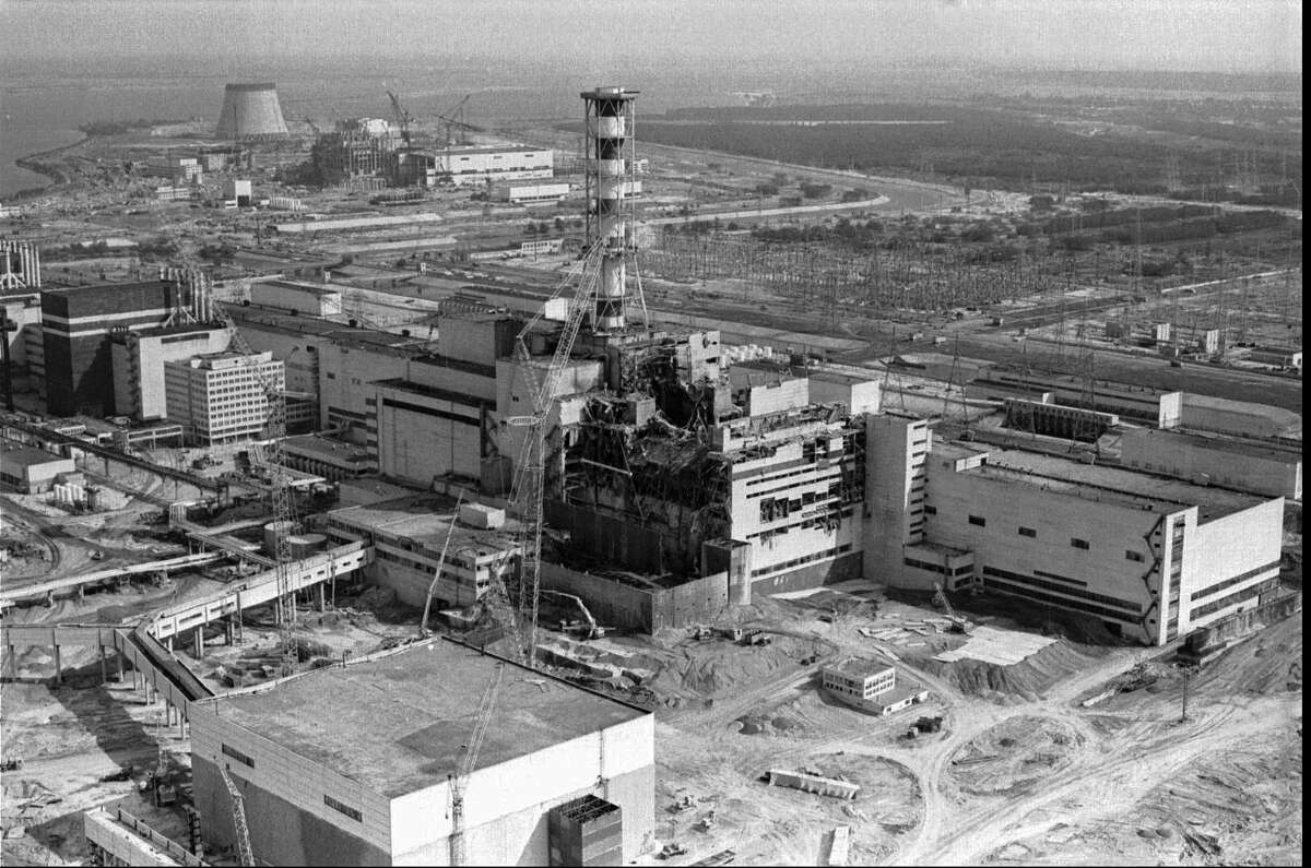 FILE - A 1986 file photo of an aerial view of the Chernobyl nuclear plant in Chernobyl, Ukraine showing damage from an explosion and fire in reactor four on April 26, 1986 that sent large amounts of radioactive material into the atmosphere. Telling the story of Chernobyl in numbers 30 years later involves dauntingly large figures and others that are even more vexing because they're still unknown. (AP Photo/Volodymyr Repik, File) ORG XMIT: LON27