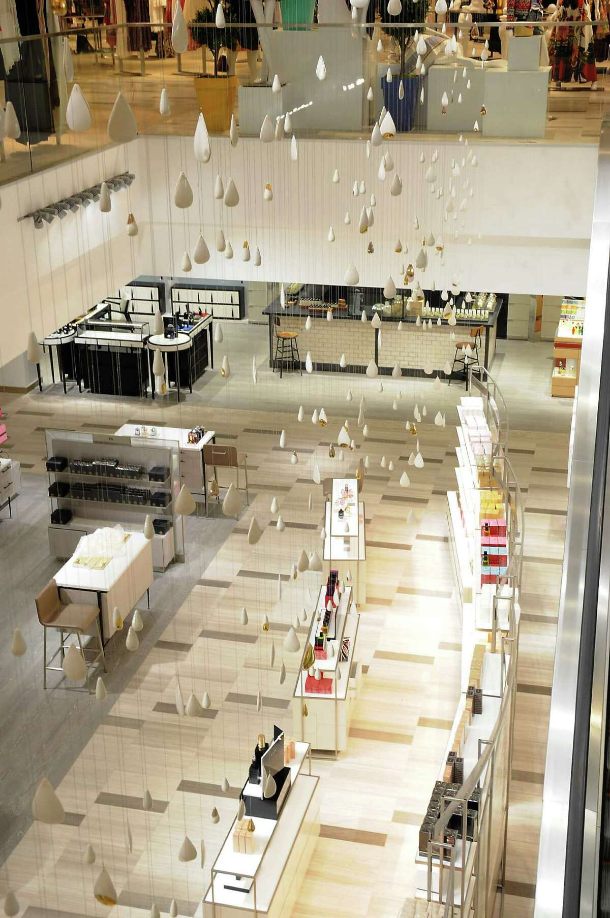 Teardrop shaped pieces hang between the first and second floors at the new Saks Fifth Avenue store in the Galleria Tuesday April 26,2016(Dave Rossman Photo)