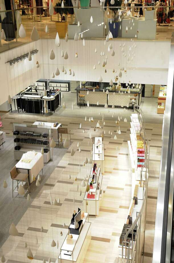 Teardrop shaped pieces hang between the first and second floors at the new Saks Fifth Avenue store in the Galleria Tuesday April 26,2016(Dave Rossman Photo) Photo: Dave Rossman, For The Chronicle / Dave Rossman