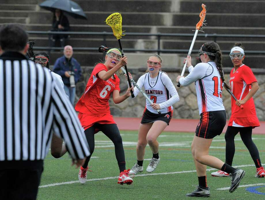Greenwich Erika Bloes (6) fires a shot on goal past Stamford Mackenzie Brown (15) during a FCIAC league game at Stamford High School on April 26, 2016. Greenwich defeated Stamford 15-7. Photo: Matthew Brown / Hearst Connecticut Media / Stamford Advocate