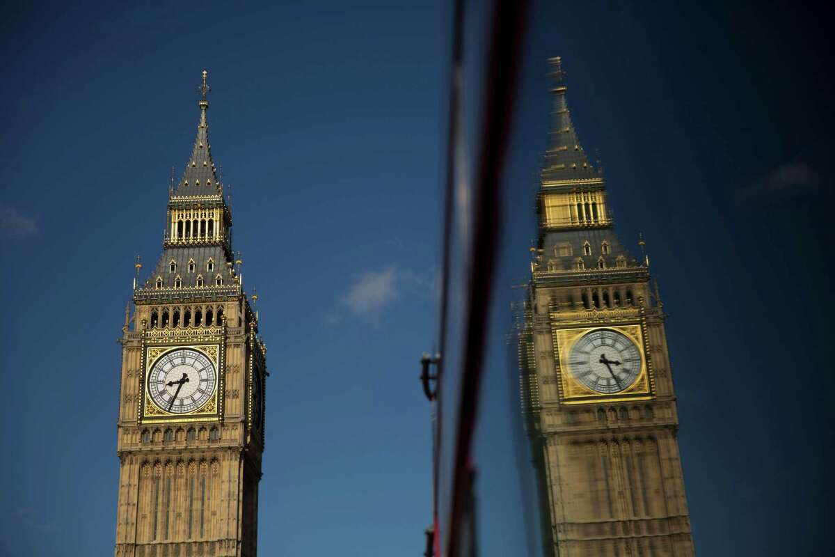 Elizabeth Tower, which houses the Big Ben bell, at the Houses of Parliament is reflected in a bus window in London, Tuesday, April 26, 2016. Officials say the chimes of Britain's Big Ben bell will fall silent for several months during a three-year restoration of Parliament's crumbling clock tower. (AP Photo/Matt Dunham)
