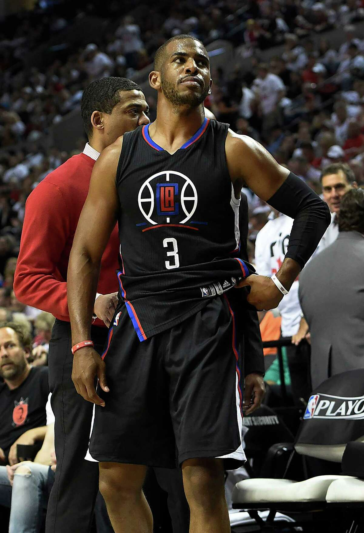 Chris Paul appears resigned to his fate as he leaves the court Monday with what turned out to be a broken right hand.