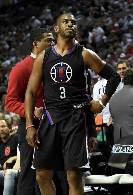 Chris Paul appears resigned to his fate as he leaves the court Monday with what turned out to be a broken right hand. Photo: Steve Dykes, Stringer / 2016 Getty Images