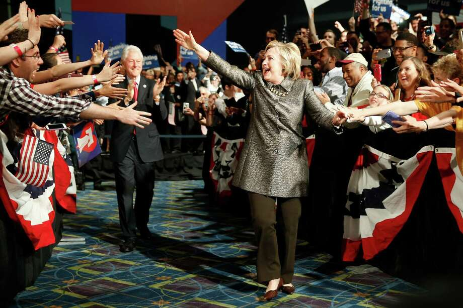 Democratic presidential candidate Hillary Clinton and Former President Bill Clinton move to the stage at her presidential primary election night rally, Tuesday, April 26, 2016, in Philadelphia. (AP Photo/Matt Rourke) Photo: Matt Rourke, STF / Associated Press / AP