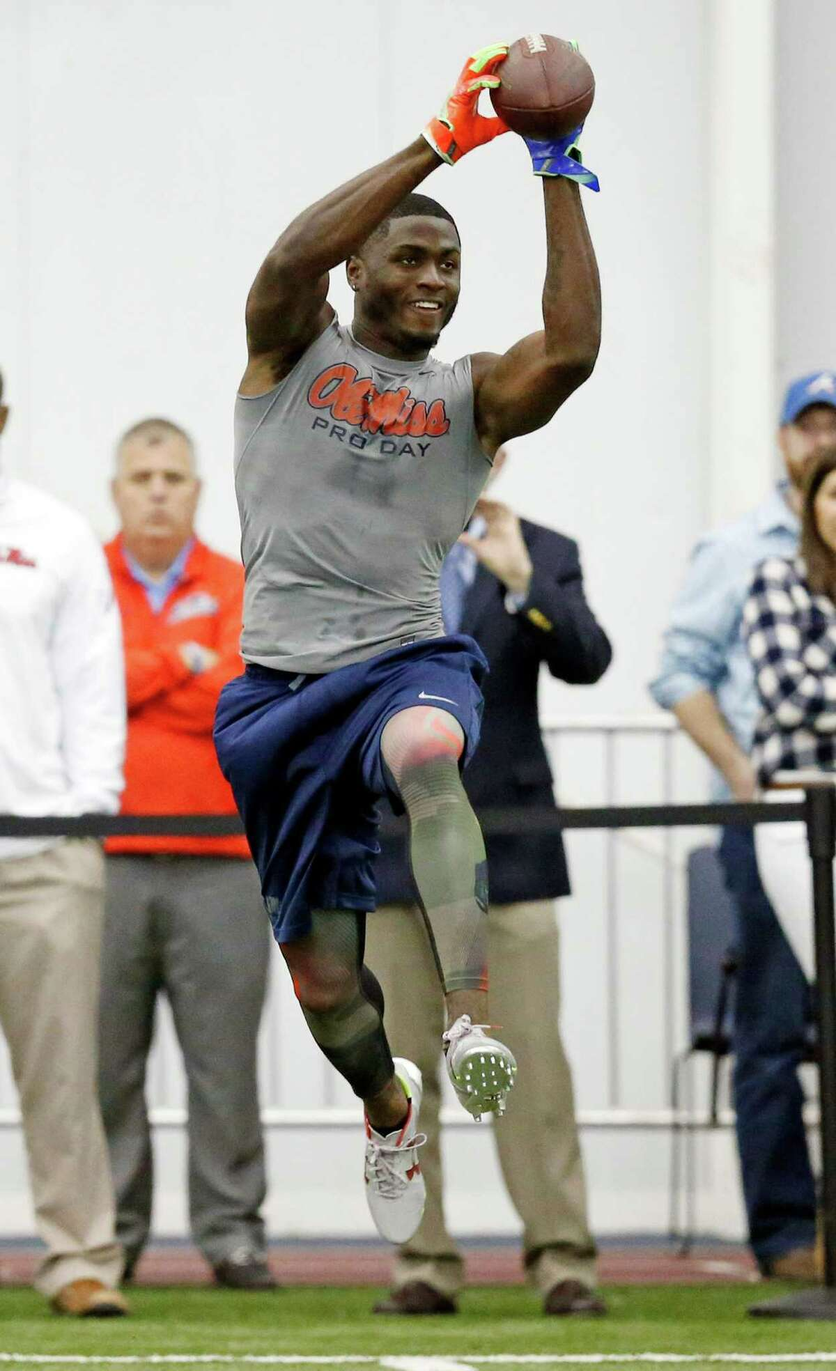 Wide receiver Laquon Treadwell reaches for a pass during drills at Mississippi's NFL football Pro Day, Monday, March 28, 2016, in Oxford, Miss. The event is to showcase players for the upcoming NFL football draft. (AP Photo/Rogelio V. Solis)
