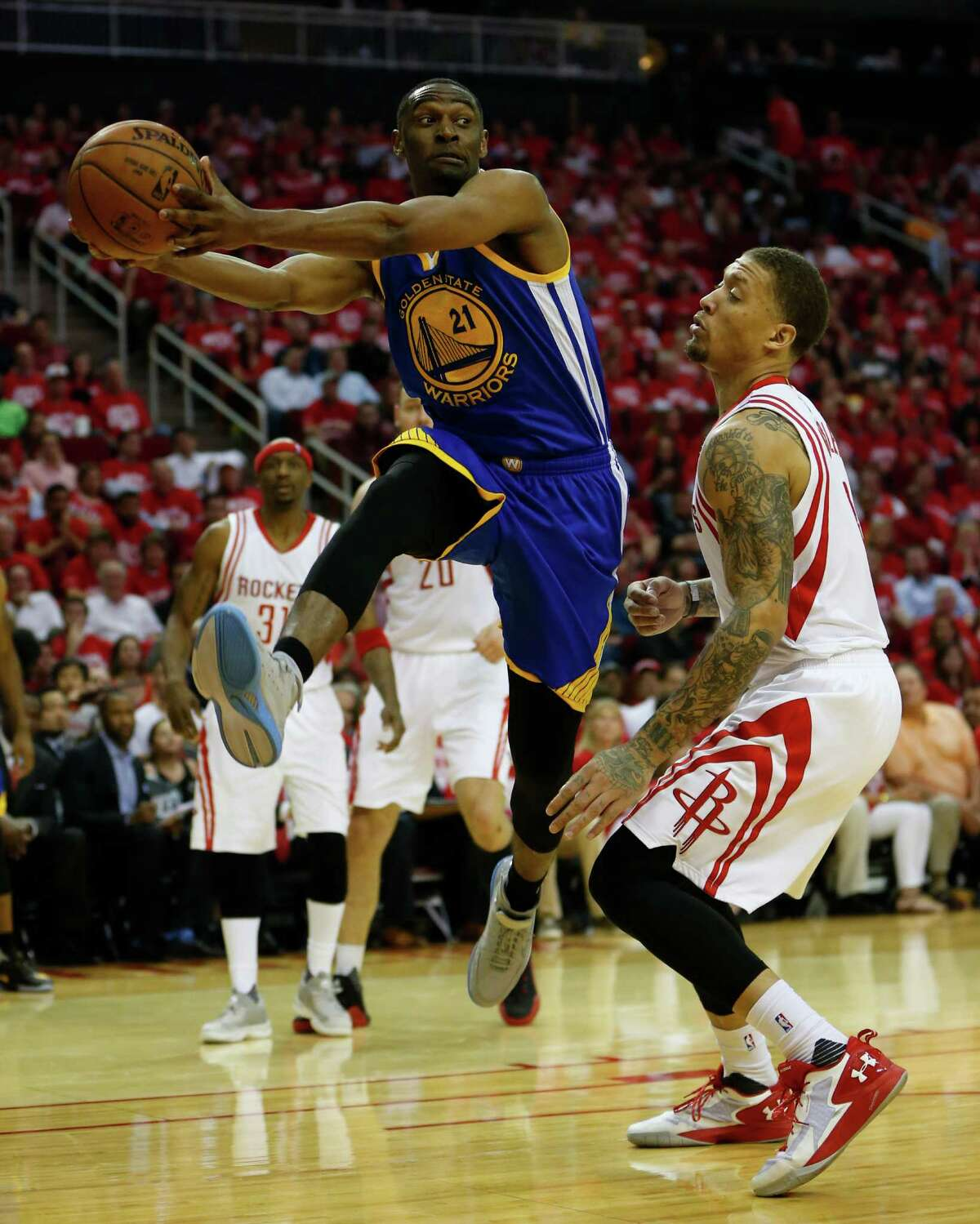 Little-used Warriors guard Ian Clark, left, was a thorn in the Rockets' side in Game 3, scoring nine points in the fourth quarter of Golden State's 97-96 loss.
