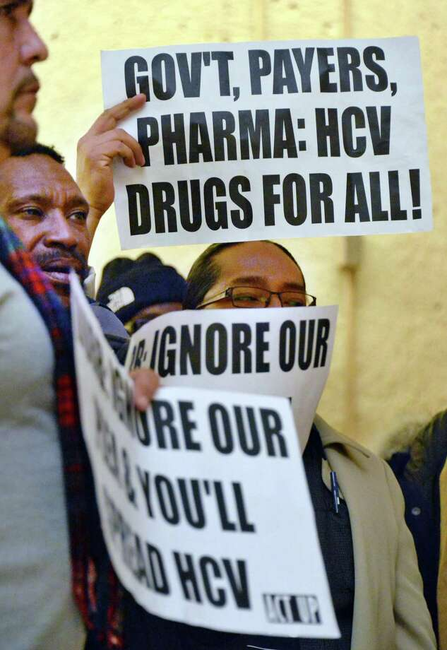 Demonstrators demand that NYS Medicaid cover new hepatitis C treatment medications during a rally Thursday, Nov. 20, 2014, outside the NYS Department of Health at Corning Tower in Albany, N.Y.  (John Carl D'Annibale / Times Union) Photo: John Carl D'Annibale / 00029571A