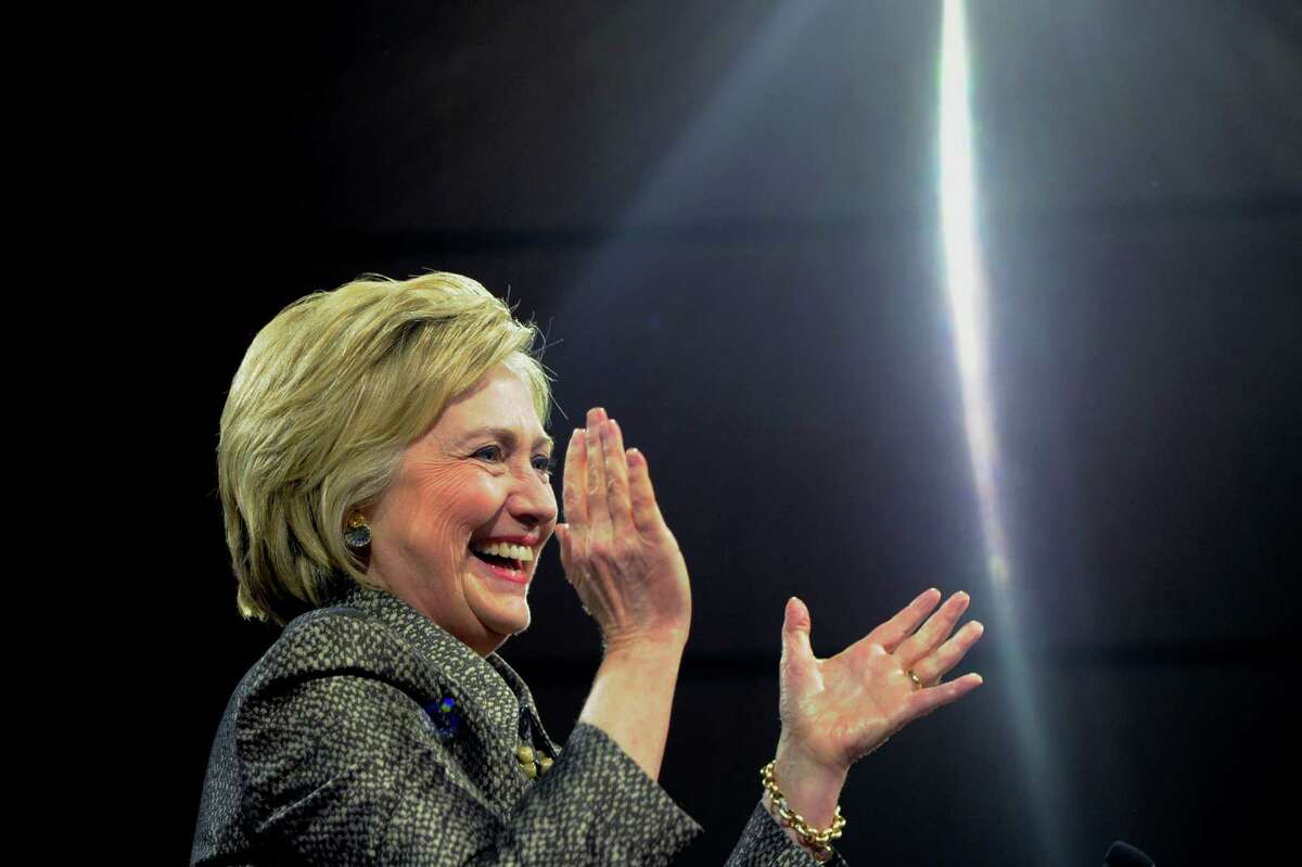 Democratic presidential candidate Hillary Clinton arrives onstage at her victory party at the Convention Center in Philadelphia on Tuesday, April 26, 2016. (Tom Gralish/The Philadelphia Inquirer via AP) MANDATORY CREDIT