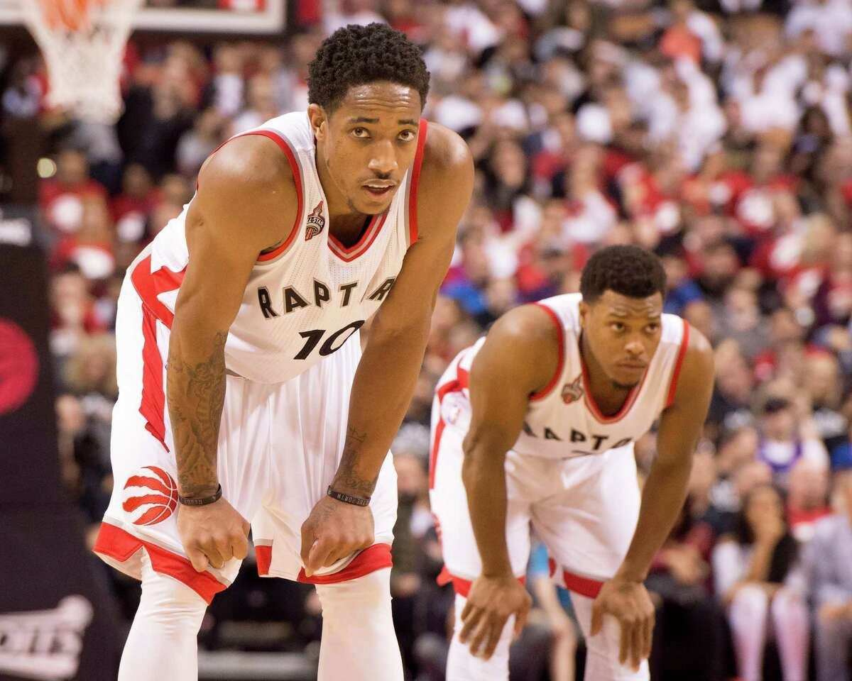 Toronto Raptors' DeMar DeRozan, left, and Kyle Lowry pause during the closing seconds against the Indiana Pacers in Game 1 in the first round of the NBA basketball playoffs in Toronto, Saturday, April 16, 2016. The Pacers won 100-90. (Frank Gunn/The Canadian Press via AP) MANDATORY CREDIT