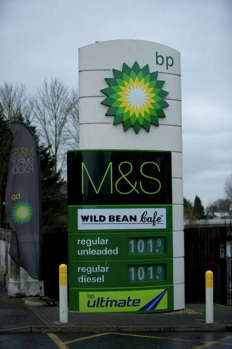 Fuel prices are displayed at a BP petrol station in East Molesey in the London area. Britain's BP saw its first-quarter earnings slump by 79 percent.  Photo: Matt Dunham, STF / AP
